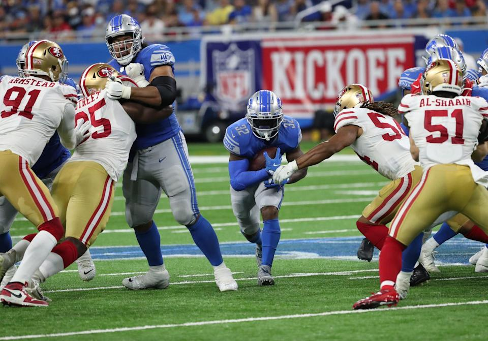Detroit Lions running back D'Andre Swift (32) runs the ball against the San Francisco 49ers Sunday, Sept. 12, 2021 at Ford Field.