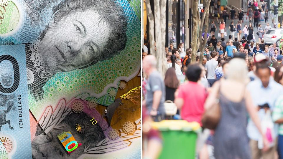 Close image of Australian currency notes, busy street in Sydney.