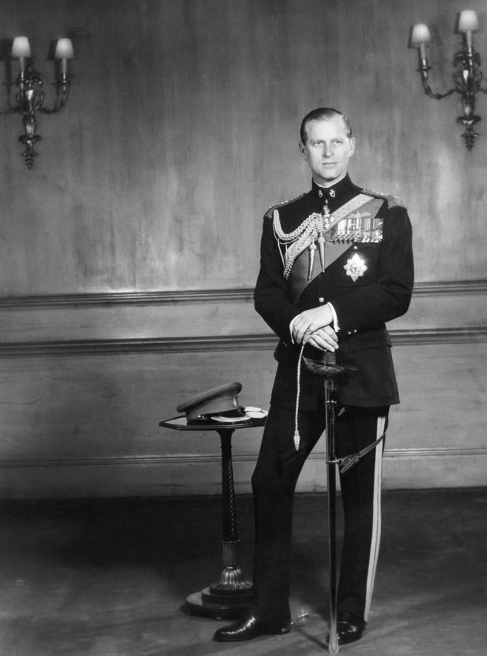FILE - In this June 10, 1956 file photo, the Duke of Edinburgh poses for a photo as he observes his 35th birthday anniversary in Buckingham Palace, London. Buckingham Palace says Prince Philip, husband of Queen Elizabeth II, has died aged 99. (AP Photo/File)
