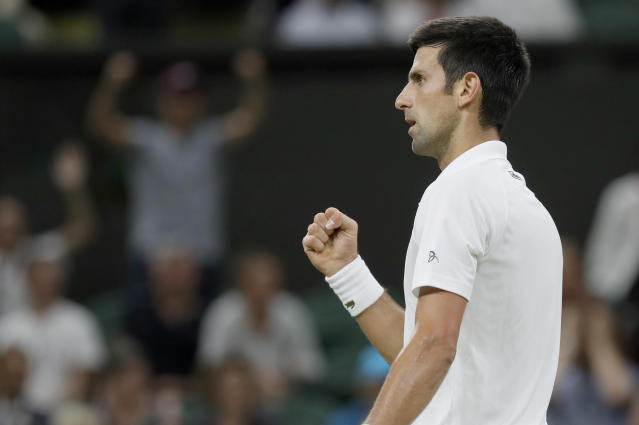 Serbia's Novak Djokovic reacts after winning a point during the men's singles semifinals match against Rafael Nadal of Spain, at the Wimbledon Tennis Championships, in London, Saturday July 14, 2018.(AP Photo/Kirsty Wigglesworth)