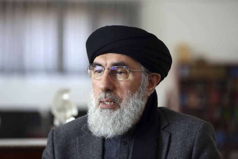 In this Tuesday, Feb. 25, 2020 photo, Afghan warlord Gulbuddin Hekmatyar, speaks during an interview to the Associated Press in his home in Kabul, Afghanistan. Many Afghans view Saturday's expected signing of a U.S.-Taliban peace deal with a heavy dose of well-earned skepticism. They've spent decades living in a country at war — for some their whole lives — and wonder if they can ever reach a state of peace. Only one militant group has ever signed a peace agreement with Ghani's government. The group's leader, Hekmatyar, said many of his fighters faced harassment, intimidation and even prison when they attempted to re-integrate. (AP Photo/Rahmat Gul)