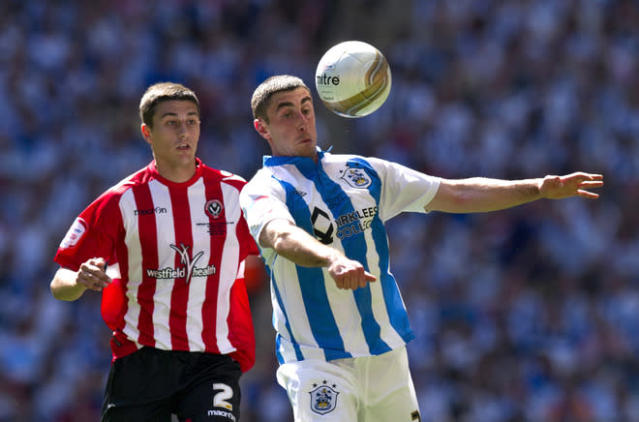 Sheffield United's Matt Lowton (L) vies for the ball against Huddersfield's Calum Woods (R) during the League 1 Play-Off Final football match between Huddersfield Town and Sheffield United at Wembley Stadium in London on May 26, 2012. AFP PHOTO / ADRIAN DENNISADRIAN DENNIS/AFP/GettyImages