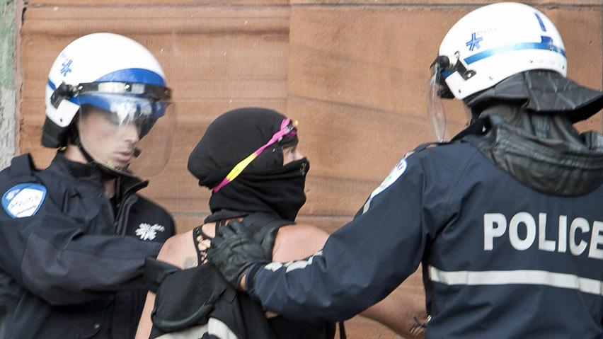 Police apprehend a protester in downtown Montreal. Security measures around this year's Canadian Grand Prix events are unusually tight.