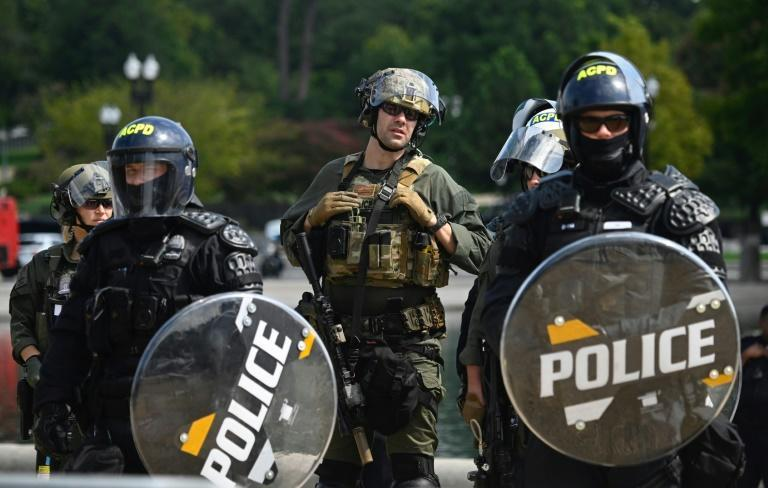 Police donned riot gear and carried shields for the rally in Washington (AFP/Andrew CABALLERO-REYNOLDS)
