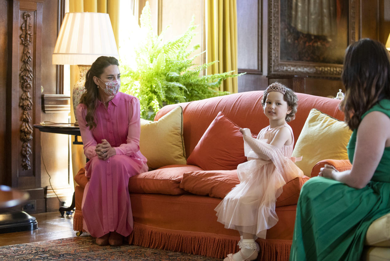 Catherine, Duchess of Cambridge wore a pink Me+Em dress during her meeting with Mila Sneddon at the Palace of Holyroodhouse, in Scotland, on May 27, 2021, as she promised the five-year-old she would match in her favourite colour. (Getty Images)