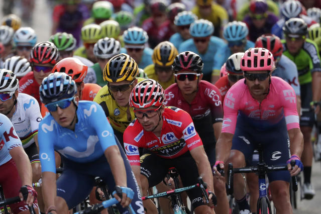 Race leader Primoz Roglic, centre, rides with the pack during the last stage of La Vuelta cycling race in Madrid, Spain, Sunday, Sept. 15, 2019. (AP Photo/Manu Fernandez)