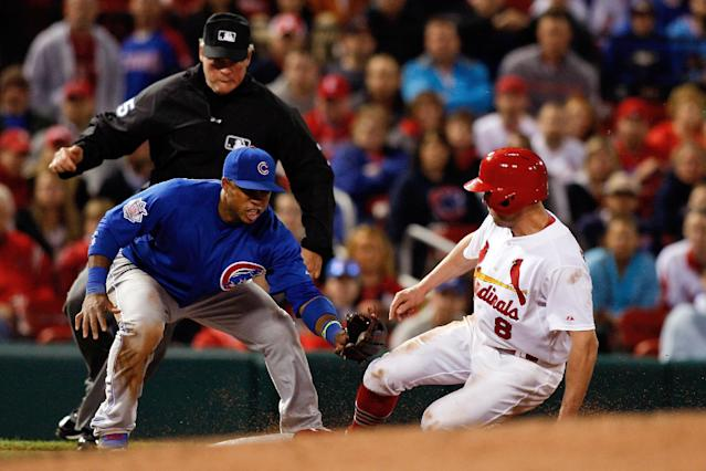 St. Louis Cardinals' Peter Bourjos steals third as Chicago Cubs third baseman Luis Valbuena is late with the tag during the sixth inning of a baseball game Tuesday, May 13, 2014, in St. Louis. (AP Photo/Scott Kane)
