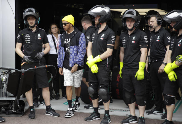 Mercedes driver Lewis Hamilton of Britain stands by technicians at the Monaco racetrack, in Monaco, Friday, May 24, 2019. The Formula one race will be held on Sunday. (AP Photo/Luca Bruno)