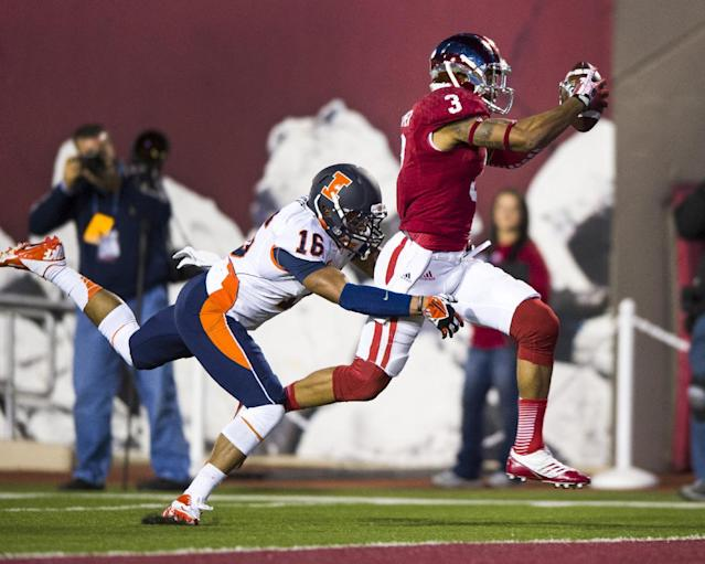 Indiana's Cody Latimer (3) runs into the end zone to score as Illinois' Caleb Day (16) reaches out in an effort to pull him down during the second half of an NCAA college football game, Saturday, Nov. 9, 2013, in Bloomington, Ind. Indiana won 52-35. (AP Photo/Doug McSchooler)
