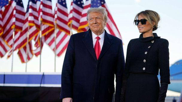 PHOTO: President Donald Trump and first lady Melania Trump look at supporters before boarding Air Force One at Andrews Air Force Base, Md., Jan. 20, 2021. (Manuel Balce Ceneta/AP)
