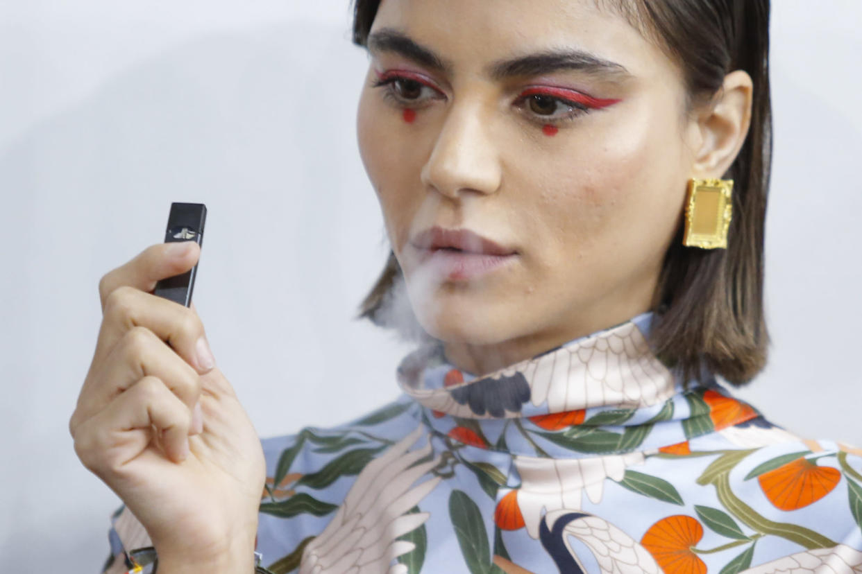A model smokes a vape before the Snow Xue Gao Spring Summer 2018 show during New York Fashion Week on September 8, 2017 in New York. (Photo: EDUARDO MUNOZ ALVAREZ/AFP/Getty Images)