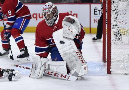 Jan 3, 2019; Montreal, Quebec, CAN; Montreal Canadiens goalie Carey Price (31) makes a save against the Vancouver Canucks during the second period at the Bell Centre. Mandatory Credit: Eric Bolte-USA TODAY Sports