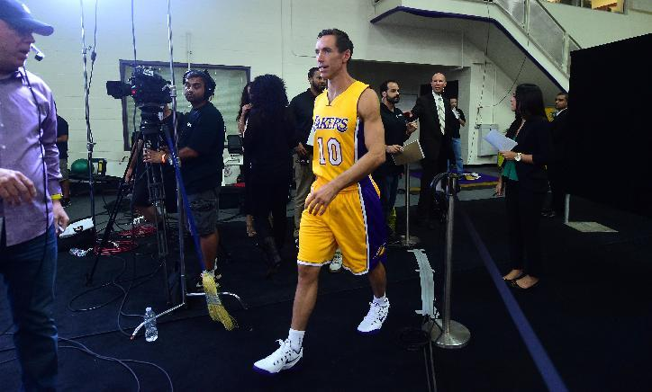 Steve Nash of the NBA's Los Angeles Lakers heads to an interview on media day in El Segundo, California on September 29, 2014