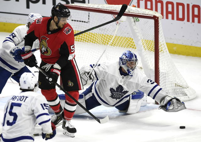 Toronto Maple Leafs goaltender Jack Campbell (36) reaches for the rebounding puck as Ottawa Senators center Artem Anisimov (51) watches during second-period NHL hockey game action in Ottawa, Ontario, Saturday, Feb. 15, 2020. (Justin Tang/The Canadian Press via AP)
