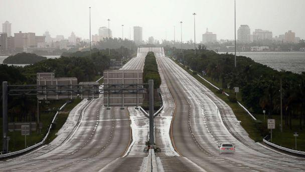PHOTO: A car drives along an empty highway in Miami before the arrival of Hurricane Irma to south Florida, Sept. 9, 2017. (Carlos Barria/Reuters)