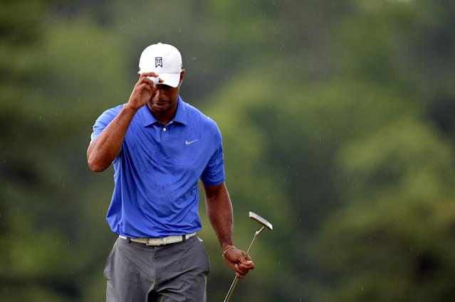 ARDMORE, PA - JUNE 13: Tiger Woods of the United States reacts on the first green during Round One of the 113th U.S. Open at Merion Golf Club on June 13, 2013 in Ardmore, Pennsylvania. (Photo by Ross Kinnaird/Getty Images)