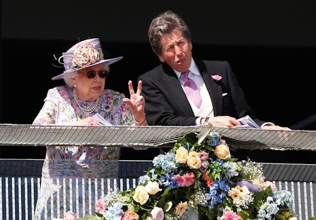 Horse Racing - Derby Festival - Epsom Downs Racecourse, Epsom, Britain - June 2, 2018 Britain's Queen Elizabeth with John Warren during Derby Festival REUTERS/Peter Nicholls