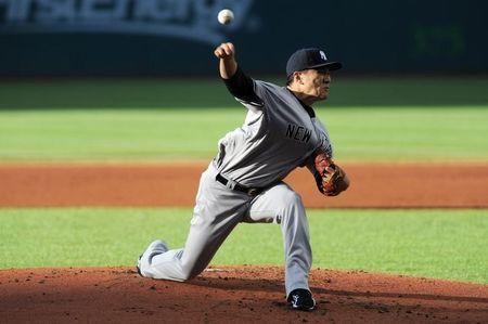 New York Yankees starting pitcher Masahiro Tanaka (19) pitches during the first inning against the Cleveland Indians at Progressive Field. Jul 8, 2014; Cleveland, OH, USA; Ken Blaze-USA TODAY Sports
