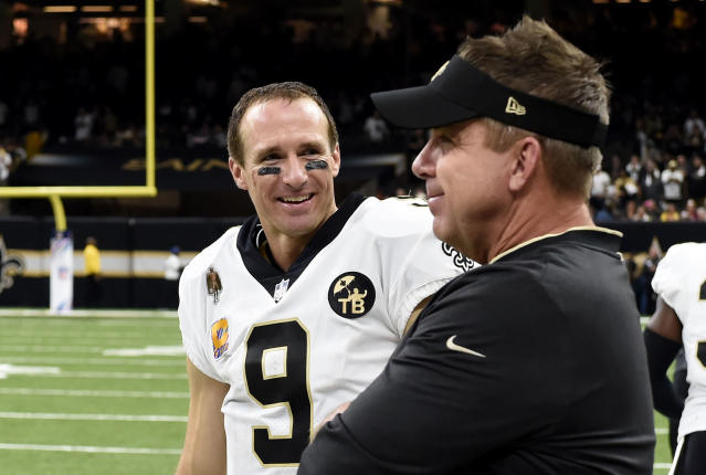 New Orleans Saints quarterback Drew Brees (9) smiles with head coach Sean Payton after being taken out of the game in the second half of an NFL football game against the Washington Redskins in New Orleans, Monday, Oct. 8, 2018. Brees broke the NFL all-time passing yards record during the game. The Saints won 43-19. (AP Photo/Bill Feig)