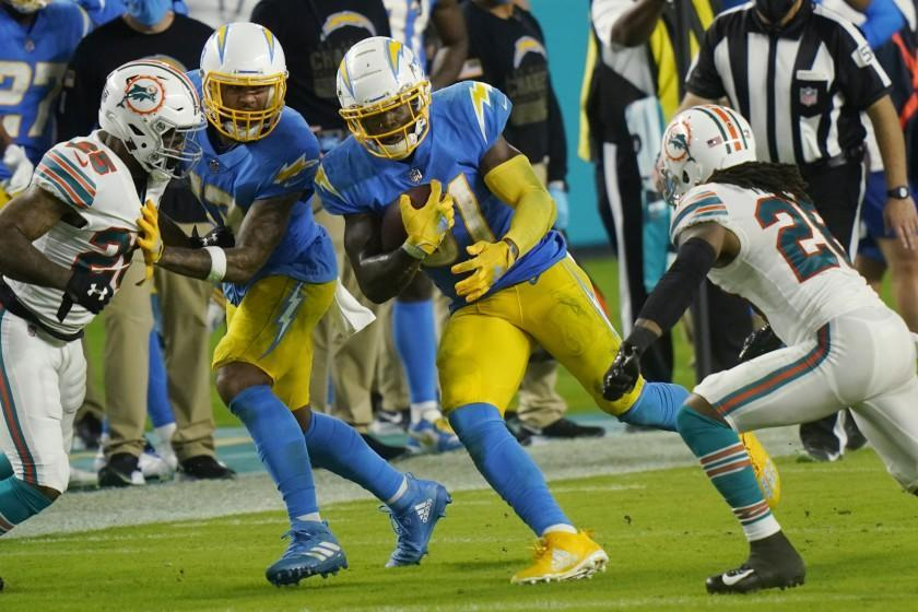 Los Angeles Chargers running back Kalen Ballage (31) runs the football during the second half.