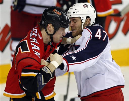 Columbus Blue Jackets' Dalton Prout, right, fights with Calgary Flames' Tim Jackman during the first period of an NHL hockey game Friday, March 29, 2013, in Calgary, Alberta. (AP Photo/The Canadian Press, Jeff McIntosh)