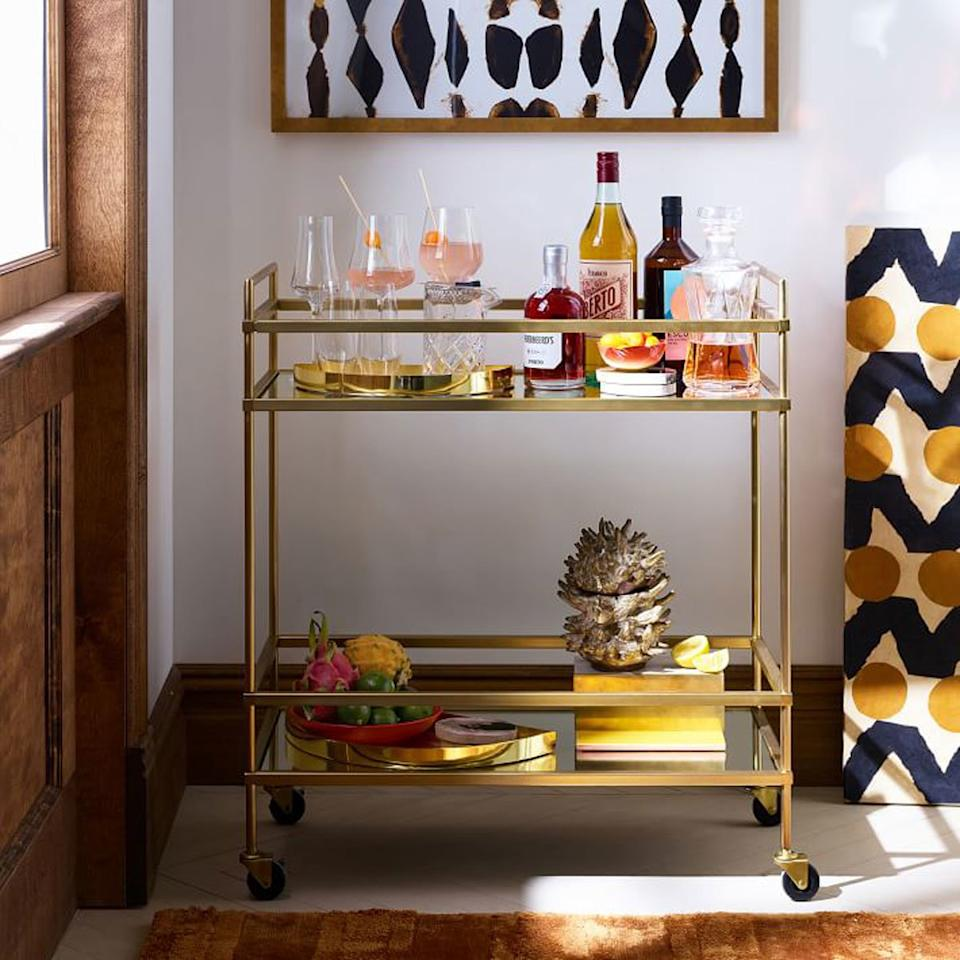"""<p>Set up a picture-perfect cocktail station with this vintage deco piece that pivots along with the party.</p> <p><em>Terrace Bar Cart, $399 at <a href=""""http://westelm.7eer.net/c/249354/267856/4336?subId1=FW%2Ccocktail-gifts-terrace-bar-cart-FT-SS1117.jpg%2Cmsoll1271%2C%2CIMA%2C1258943%2C201907%2CI,FW&u=http%3A%2F%2Fwww.westelm.com%2Fproducts%2Fterrace-bar-cart-h1012%2F"""" target=""""_blank"""">West Elm</a></em></p>"""