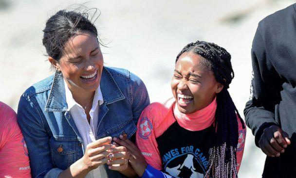 PHOTO: Meghan, the Duchess of Sussex, laughs with members of the NGO Waves for Change, during their African tour, on Monwabisi Beach in Cape Town, South Africa, Sept. 24, 2019. (Mike Hutchings/Reuters)