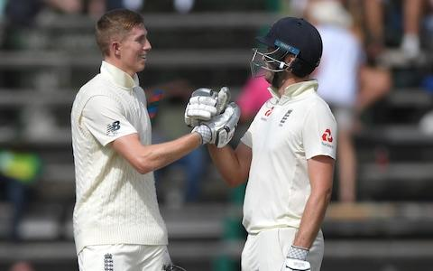 England batsmen Zak Crawley and Dom Sibley celebrate their 100 partnership during Day One of the Fourth Test between South Africa and England at The Wanderers on January 24, 2020 in Johannesburg, South Africa - Credit: Getty Images