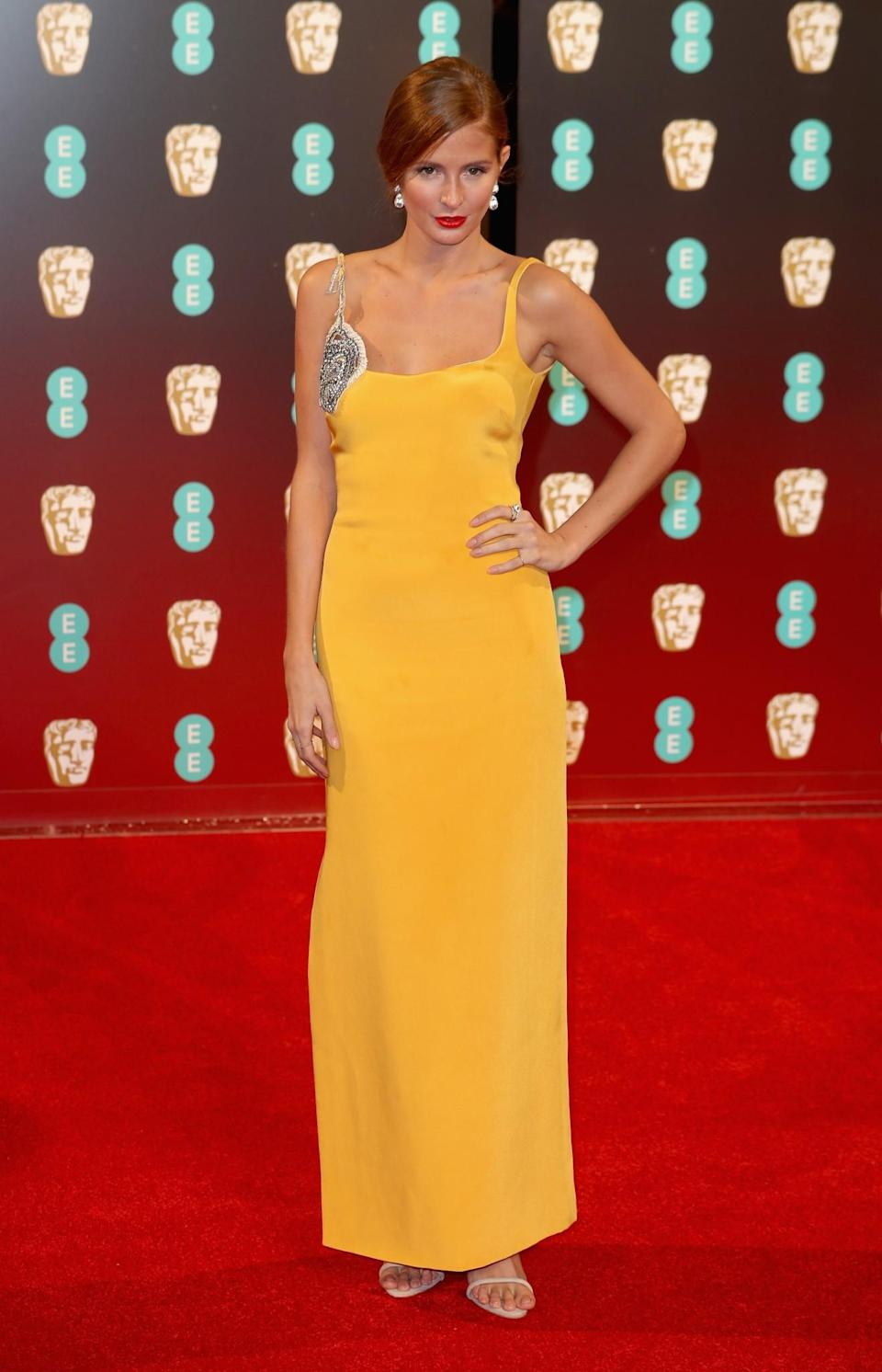 <p>Millie dressed in a sunny strappy gown. <i>[Photo: Getty]</i> </p>
