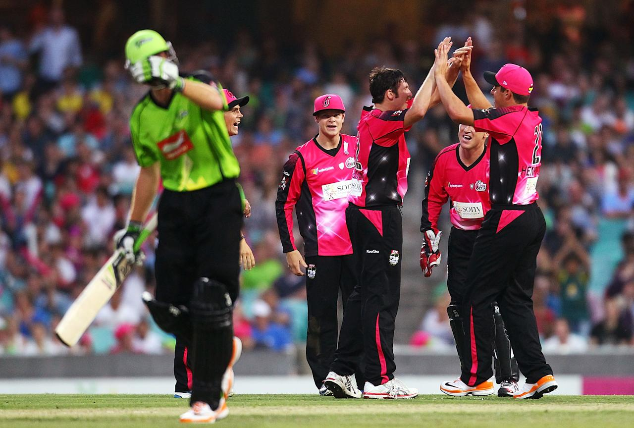 SYDNEY, AUSTRALIA - DECEMBER 08: Luke Feldman of the Sixers celebrates with team mates after getting the wicket of Martin Guptill of the Thunder during the Big Bash League match between the Sydney Sixers and the Sydney Thunder at Sydney Cricket Ground on December 8, 2012 in Sydney, Australia.  (Photo by Mark Nolan/Getty Images)