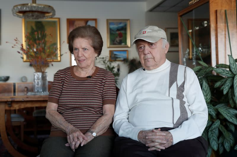 Lea Evron and her husband Yehuda listen to a question during an interview at their apartment in the Queens borough of New York