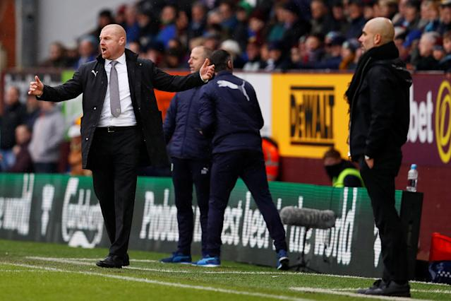 "Soccer Football - Premier League - Burnley vs Manchester City - Turf Moor, Burnley, Britain - February 3, 2018 Burnley manager Sean Dyche reacts as Manchester City manager Pep Guardiola looks on Action Images via Reuters/Jason Cairnduff EDITORIAL USE ONLY. No use with unauthorized audio, video, data, fixture lists, club/league logos or ""live"" services. Online in-match use limited to 75 images, no video emulation. No use in betting, games or single club/league/player publications. Please contact your account representative for further details."