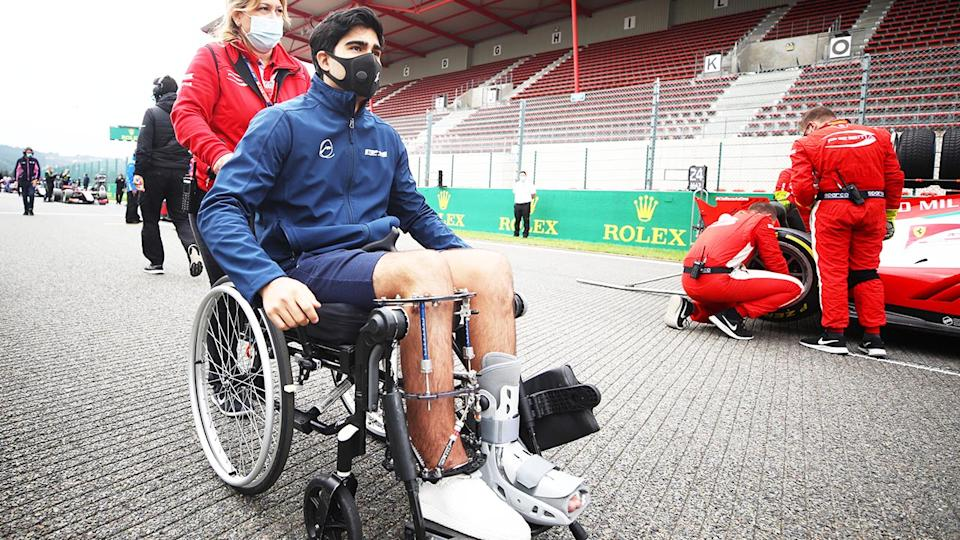 Juan Manuel Correa (pictured) is pushed in a wheelchair after suffering horrific injuries in an F2 crash. (Getty Images)