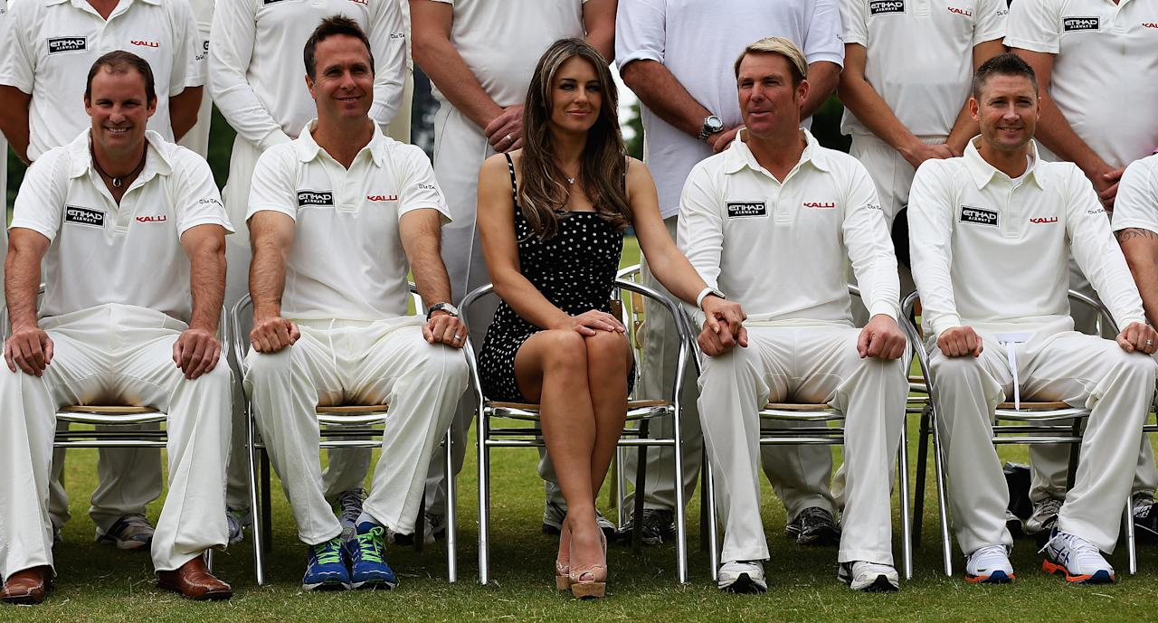 CIRENCESTER, ENGLAND - JUNE 09:  Michael Vaughan, Elizabeth Hurley and Shane Warne look on during the Shane Warne's Australia vs Michael Vaughan's England T20 match at Circenster Cricket Club on June 9, 2013 in Cirencester, England.  (Photo by Matthew Lewis/Getty Images)