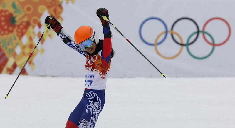 Violinst Vanessa Mae starting under her father name as Vanessa Vanakorn, celebrates in the finish area after completing the first run of the women's giant slalom at the Sochi 2014 Winter Olympics, Tuesday, Feb. 18, 2014, in Krasnaya Polyana, Russia.(AP Photo/Christophe Ena)