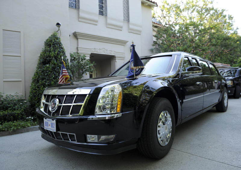 President Barack Obama's limousine is parked in front of the home Disney Studios Chairman Alan Horn and his wife Cindy in Bel Air, Calif., Wednesday, May 7, 2014. Obama is attending a Democratic party fundraiser and will later received an award from the foundation created by movie director Steven Spielberg. Obama is spending 3 days in California where he will raise money for the Democratic Party. (AP Photo/Susan Walsh)
