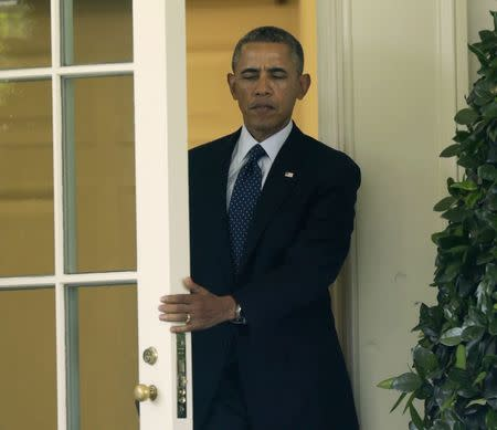 United States President Obama departs the Oval Office at the White House in Washington