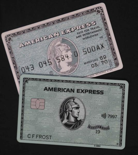 "In this Wednesday, Oct. 23, 2019, photo the original American Express ""Green Card,"" top, shown with the latest version of the card in New York. For 50 years the ""Green Card"" was everywhere and has been revamped, with a new look and more travel benefits. (AP Photo/Bebeto Matthews)"