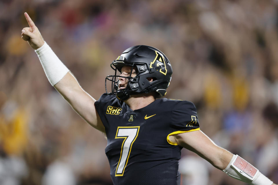 Appalachian State quarterback Chase Brice (7) celebrates after throwing a touchdown pass against East Carolina during the second half of an NCAA football game on Thursday, Sept. 2, 2021, in Charlotte, N.C. (AP Photo/Nell Redmond)