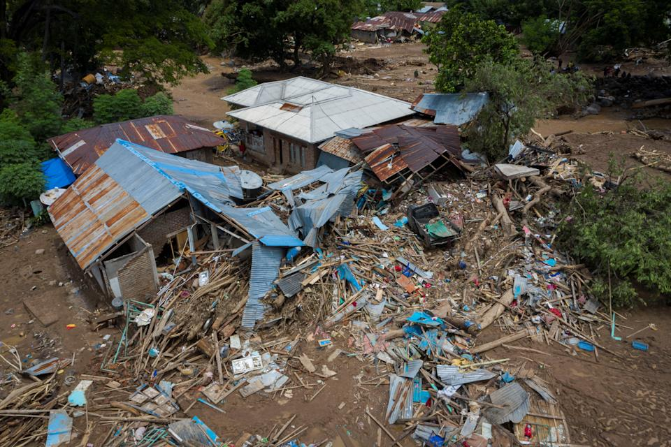 An aerial picture shows damaged houses following flash floods triggered by tropical cyclone Seroja in East Flores, East Nusa Tenggara province, Indonesia.