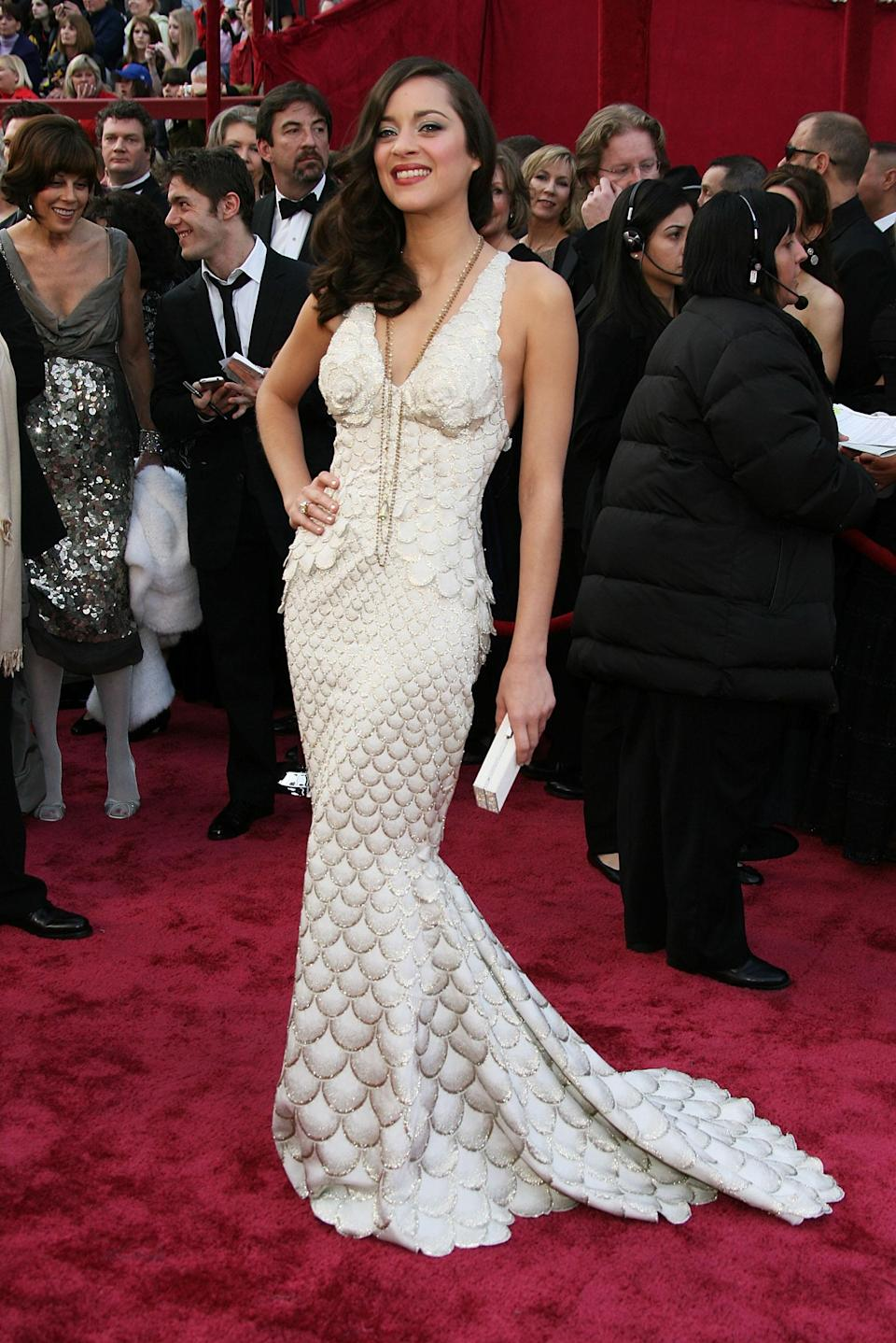 A full-length, white and gold Jean Paul Gaultier gown was French actress Marion Cotillard's pick in 2008. The actress scooped one of the coveted gongs for her portrayal of Edith Piaf in 'La Vie en Rose'.