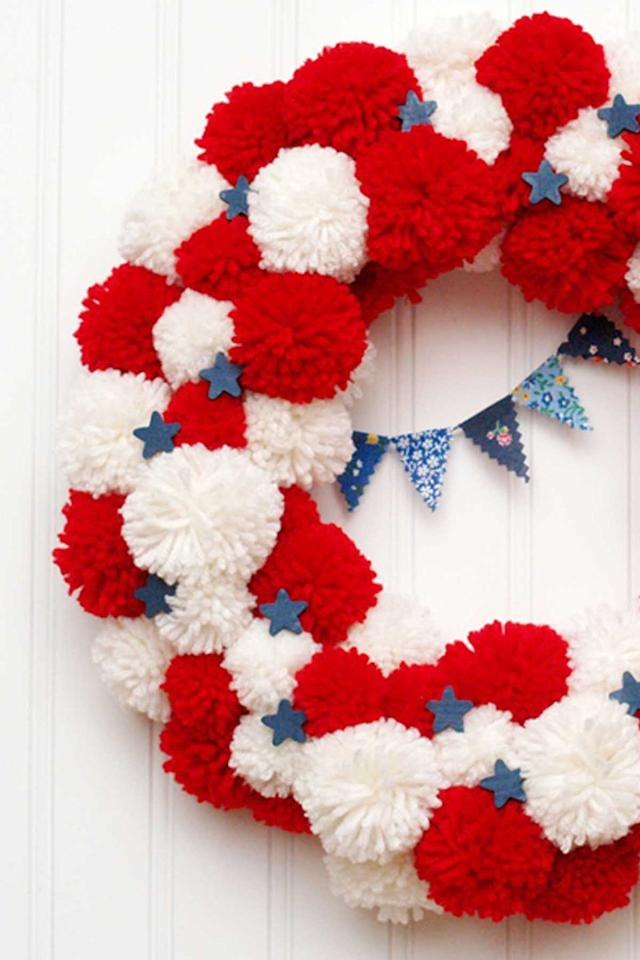 "<p>This whimsical wreath is made entirely of pom-poms  -  how cute!  </p><p><strong>Get the tutorial at <a rel=""nofollow"" href=""http://www.flamingotoes.com/2014/06/patriotic-pom-pom-wreath/"">Flamingo Toes</a>. </strong></p>"