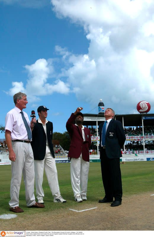 FILE PHOTO: West Indies captain Brian Lara tosses the coin as England captain Michael Vaughan, Bob Willis and official look on