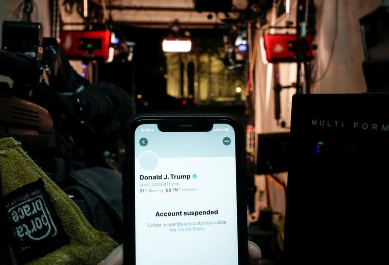 A photo illustration shows the suspended Twitter account of U.S. President Donald Trump on a smartphone in a media board cast tent at the White House in Washington