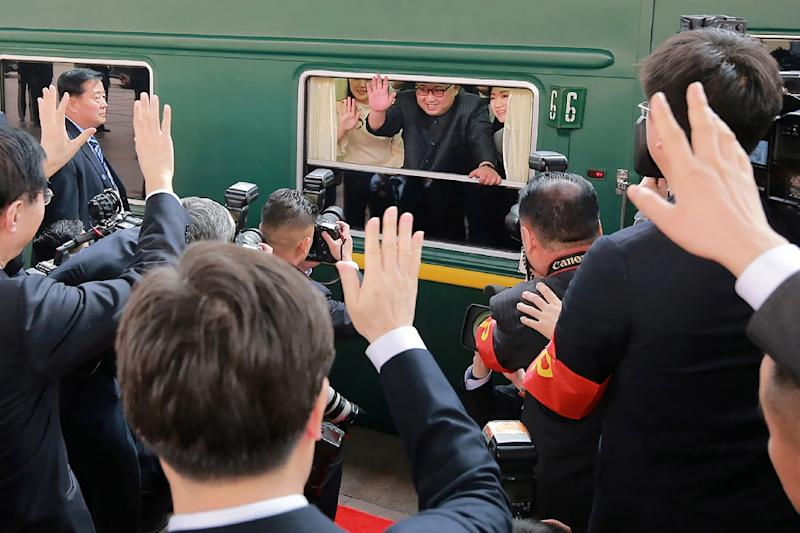 Kim Jong Un (C) has made the trip to Beijing several times in his personal train (AFP Photo/-)