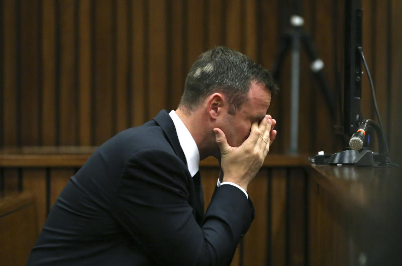 Oscar Pistorius listens to ballistic evidence being given in court in Pretoria, South Africa, Wednesday, March 19, 2014. Pistorius is on trial for the murder of his girlfriend Reeva Steenkamp on Valentine's Day in 2013. (AP Photo/Themba Hadebe, Pool)