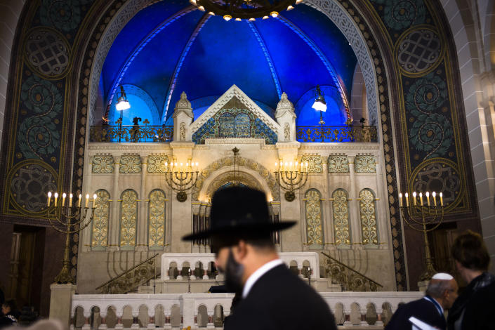 FILE - In this Friday, Nov. 9, 2018 file photo a rabbi arrives at the synagogue Rykestrasse in the district Prenzlauer Berg in Berlin, to attend an event commemorating the Night of Broken Glass 1938, in which Nazis burned and vandalized synagogues and Jewish businesses across the country and killing over 400 people. A new survey says about one in four Europeans hold anti-Semitic beliefs, with such attitudes on the rise in eastern countries and mostly steady in the west. (AP Photo/Markus Schreiber, file)