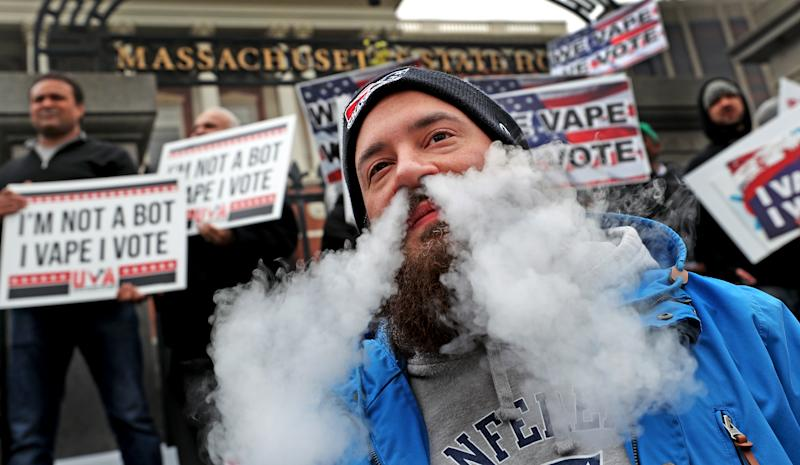 BOSTON, MA - NOVEMBER 19: Anthony Caldalda of Holyoke vapes in protest during a demonstration against Massachusetts Governor Charlie Baker's vaping ban on the front steps of the Massachusetts State House in Boston on Nov. 19, 2019. (Photo by David L. Ryan/The Boston Globe via Getty Images)