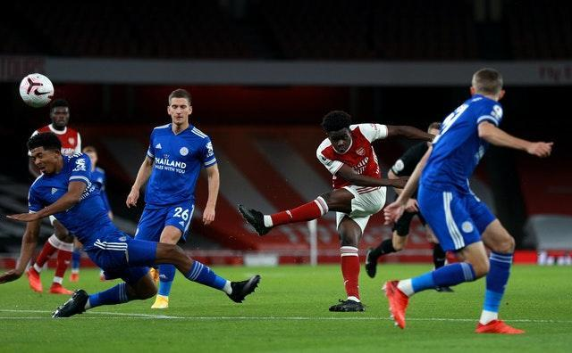 Bukayo Saka has a shot under pressure from multiple Leicester defenders
