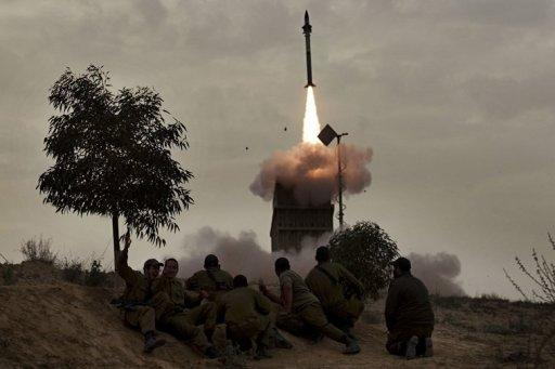 Israeli soldiers watch as a missile is launched from the Iron Dome defence system in March